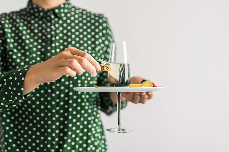 It's the perfect one-handed plate with a glass holder for the champagne glass